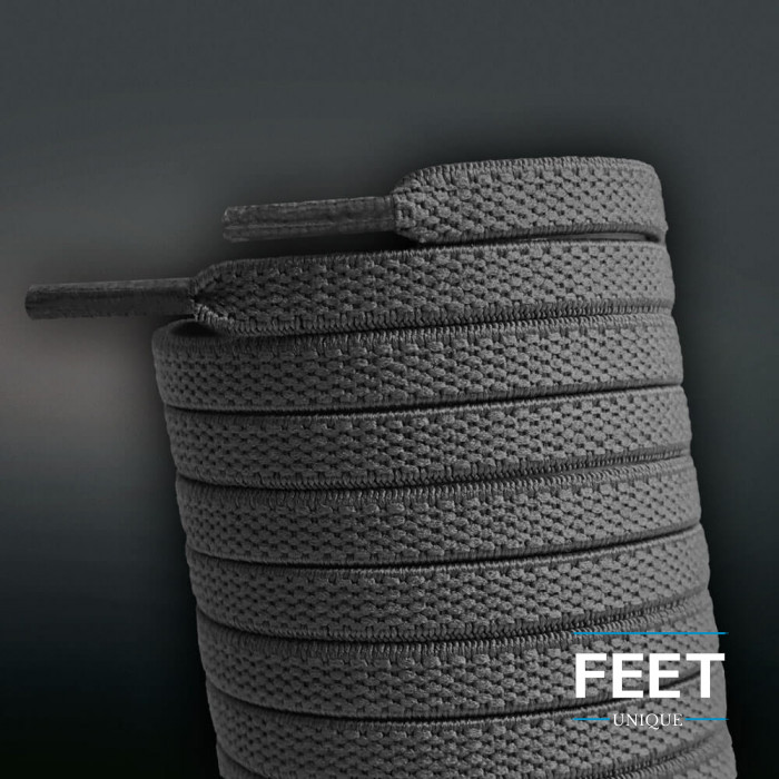Flade, elastiske mørkegrå snørebånd (no-tie)
